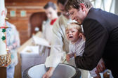 Little baby boy being baptized — Stockfoto