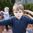 Stock Photo: Two little brothers toddlers playing in garden