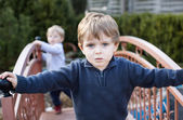 Two little brothers toddlers playing in garden — Stock Photo