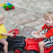 Stock Photo: Two little brothers toddlers playing with cars