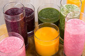 Four fruit, berry and vegetables healthy smoothies — Stock Photo