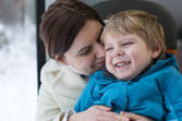 Mother and toddler son having fun in train — Stock fotografie