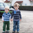 Stock Photo: Two little brothers toddlers walking