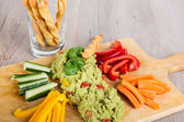 Fresh vegetables with guacamole — Stock Photo