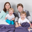 Happy family of a four having fun at home — Stock Photo #25013113