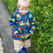 Little toddler boy in rain clothes, outdoors — Stock Photo
