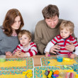 Happy family of a four having fun at home — Stock Photo #25941303