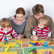 Happy family of a four having fun at home — Stock Photo #25945907