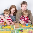 Happy family of a four having fun at home — Stock Photo #25949923