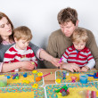 Happy family of a four having fun at home — Stock Photo #25959407