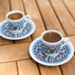 Traditional fresh turkish coffee on wooden table — Stock Photo