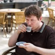 Young man drinking traditional turkish mocca coffee — Stock Photo