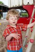 Little toddler boy sitting on playground — Stock Photo