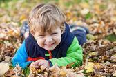 Little toddler boy having fun in autumn park — Stock Photo