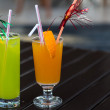 Colorful cocktails with straw on wood table  — Stock Photo