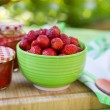 Homemade strawberry jam in different jars and fresh ripe strawbe — Stock Photo