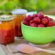 Homemade strawberry jam in different jars and fresh ripe strawbe — ストック写真
