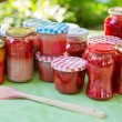 Homemade strawberry jam in different jars — Stock Photo