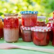 Homemade strawberry jam in different jars — Stock Photo #28320731