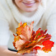Bouquet of autumn leaves in woman hand — Stock Photo