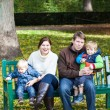 Stock Photo: Family of four at beautiful autumn day