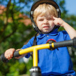 Little toddler boy riding on his bycicle in summer  — Stock Photo