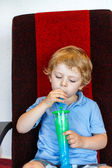 Little boy drinking colorful frozen slush ice — Stock Photo