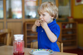 Little boy of two years having breakfast at nursery — Stock Photo