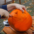 Hollowing out a pumpkin to prepare halloween lantern — Stock Photo