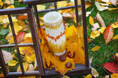 Antique lantern decorated with autumn leaves and candle — Stock Photo