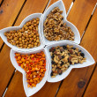 Different kinds of nuts as a salty snack — Stock Photo