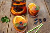Berry sangria - summer cocktail, decorated with berries, orange — Stock Photo