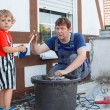 Little toddler boy helping his father with renovation of home — Stock Photo