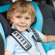 Little boy sitting in safety car sea — Stock Photo