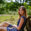 Portrait of young beautiful woman relaxing in summer forest — Stock Photo