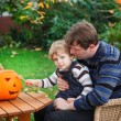 Stock Photo: Young mand toddler boy making halloween pumpkin