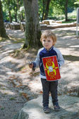 Happy little toddler boy with knight armor — Stock Photo