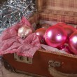 Stock Photo: Ancient pink Christmas tree toys in antique suitcase