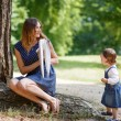 Beautiful little girl and her young mother having fun together — Stock Photo