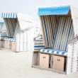 Colorful beach chairs with stripes at the beach of St.Peter Ordi — Stock Photo