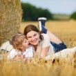 Young mother and her little son having fun at picnicking — Stock Photo