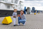 Little boy having fun in city harbor, Germany — Stock Photo