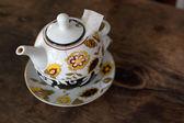 Pot of tea with jasmine on wooden background — Stock Photo