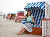 Young happy woman on the beach of St.Peter Ording, North Sea, — Stock Photo