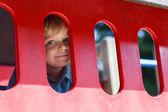Little boy having fun on city playground on sunny day — Stock Photo
