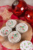 Christmas cookies and cream cheesecakes in muffin forms — Stock Photo