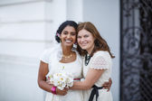 Beautiful happy indian bride and her friend — Stock Photo