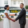 Beautiful indian bride and caucasian groom, after wedding ceremo — Stock Photo #32462495