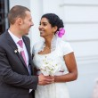 Beautiful indian bride and caucasian groom, after wedding ceremo — Stock Photo #32462497