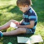 Little boy reading letter — Stock Photo #32464483